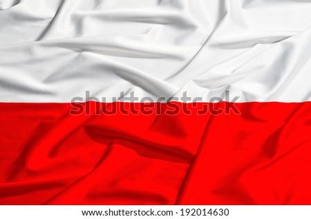 Waving Polish flag on a silk drape. - stock photo