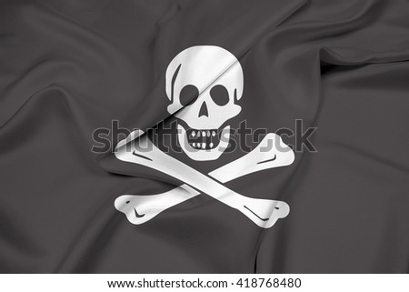 Waving The traditional Jolly Roger of piracy Flag - stock photo