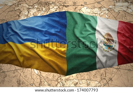 Waving Ukrainian and Mexican flags of the political map of the world