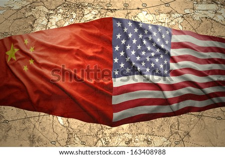 Waving United States of America and Chinese flags on the background of the political map of the world - stock photo