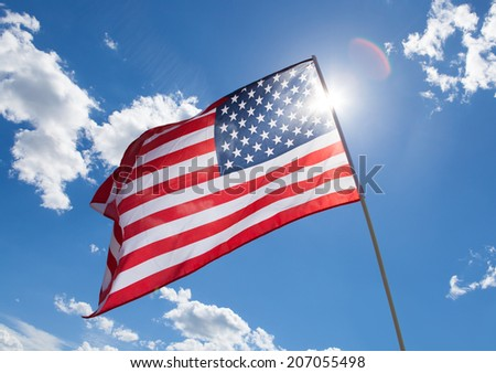 Waving USA flag on blue sky background - stock photo