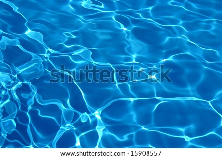 Wavy blue pool water reflecting the sky