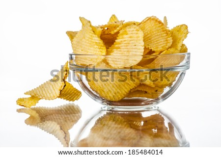 Wavy chips in a bowl - stock photo