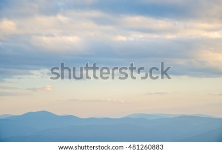 wavy colorful mountains. motley mountains. mountains covered with pine forest. saturated colors colorful sunset . Summers are warm and beautiful sunset .