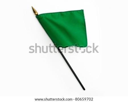 Wavy Green Silk Flag on Pole isolated on white background - stock photo