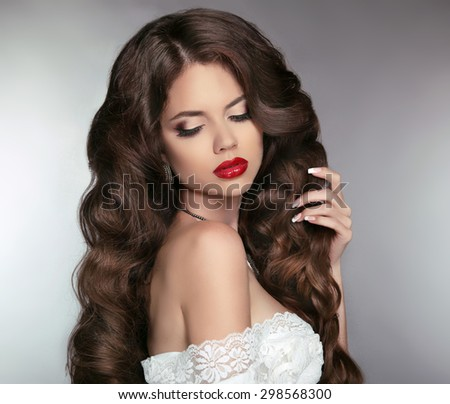 Wavy Hair. Beautiful Brunette Girl. Makeup. Red Lips. Healthy Long Hair. Beauty Model Woman. Curly Hairstyle. - stock photo