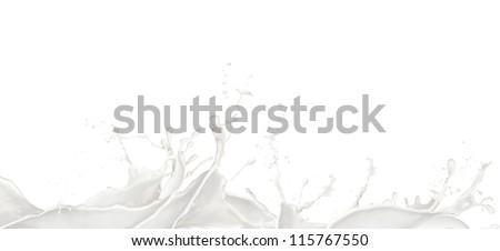 Wavy Milk splashes, isolated on white background - stock photo