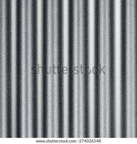 wavy pattern or corrugated chrome metal sheet background. - stock photo