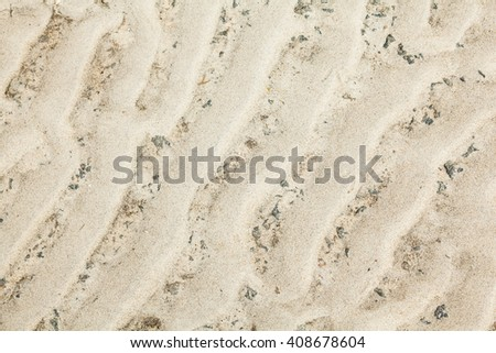 Wavy sand surface with the relief formed by wind gusts. - stock photo