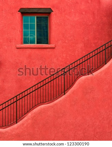 Wavy stairs on adobe red building - stock photo