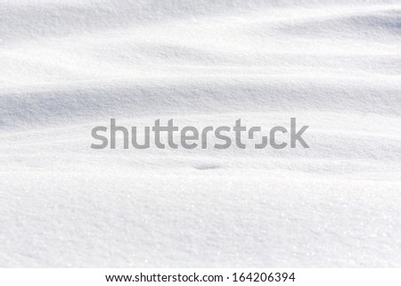 Wavy surface of pure white snow - stock photo