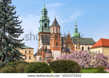 Wawel castle in the spring with blooming magnolia trees, Cracow, Poland