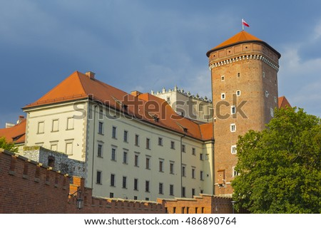 Wawel castle lit by the sun over dramatic sky, Krakow, Poland