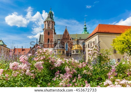 Wawel Cathedral, Cracow, Poland. View from courtyard with flowers. Blue sunny sky