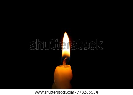 Wax candle burning in darkness, closeup