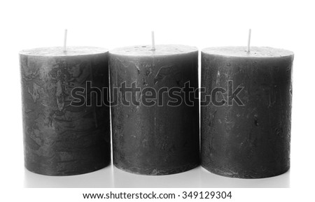 Wax grey candles isolated on white background - stock photo