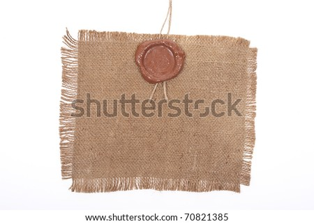 Wax seal on sackcloth material - stock photo