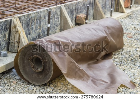 Waxed paper underlayment for concrete slab installation, moisture barrier during concreting floors pouring works. . Selective focus and shallow dof. - stock photo