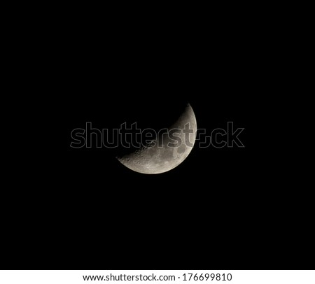Waxing crescent moon showing craters - stock photo