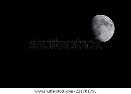 Waxing gibbous moon at night with copy space - stock photo