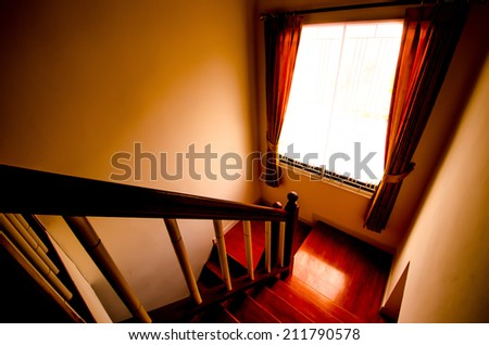 Way down the dark stairs scary with light window and curtains. Dark and retro style - stock photo