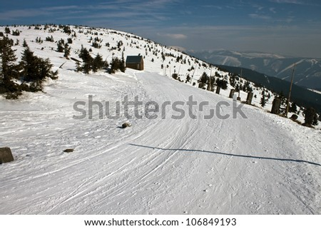 Way in snow covered mountains Krkonose (Giant mountains) in Czech Republic