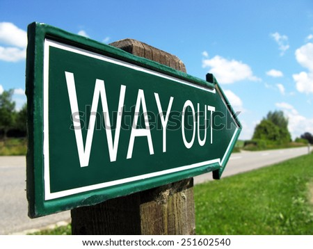 WAY OUT  signpost along a rural road - stock photo