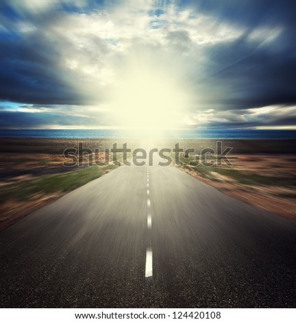 way over cloudy stormy sky and sun - stock photo