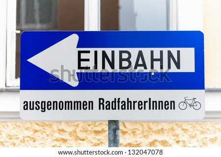 way street, road sign with extra, except for cyclists - stock photo