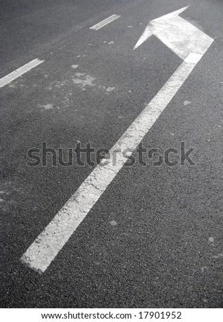 Way symbol on asphalt: Left Turn - stock photo