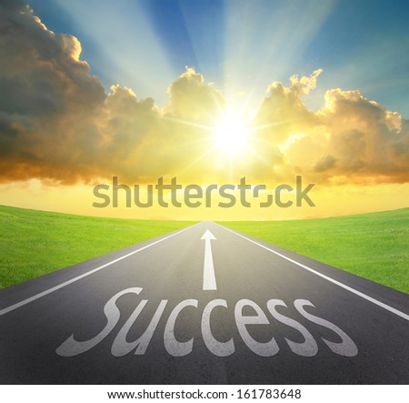 Way to Success, road symbolizing the improvement of success and sunrise with asphalt road and green grass, great for your design and concept - stock photo