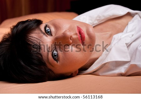 WBeautiful woman laying in the bed