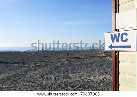 WC sign by the sea