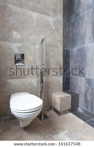 Wc with silver bar for disabled person  - stock photo