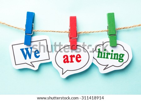 We are hiring concept paper speech bubbles with line on the light blue background. - stock photo