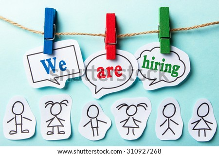We are hiring paper speech bubbles and some paper person under them. - stock photo