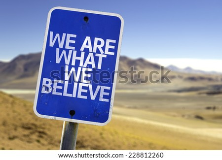 We Are What We Believe sign with a desert background