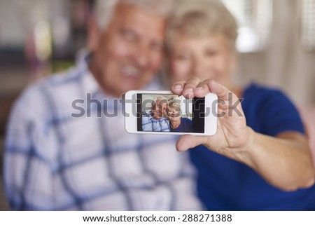 We aren't too old to take a selfie - stock photo