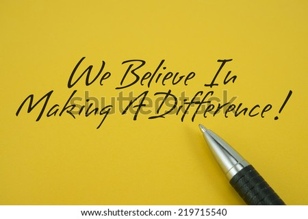 We Believe In Making A Difference! note with pen on yellow background