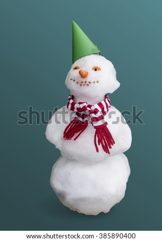 We built a snowman and dressed it in a scarf.