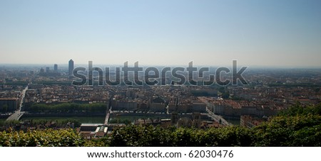We can see a landscape of Lyon seen from the hill of the basilica fourvi?re, we see the rhone, many buildings and roads. - stock photo