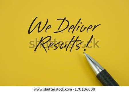 We Deliver Results! note with pen on yellow background
