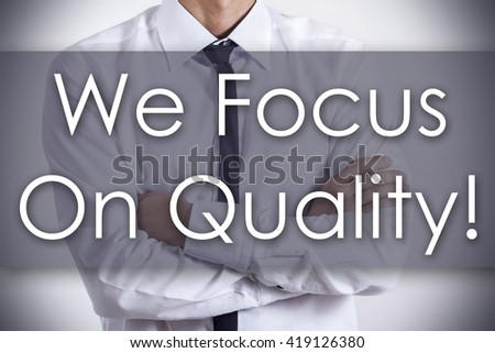 We Focus On Quality! - Closeup of a young businessman with text - business concept - horizontal image