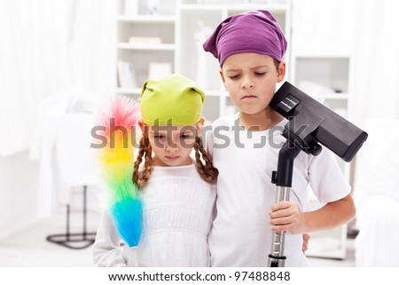 We hate these cleaning up days - upset kids in their room - stock photo