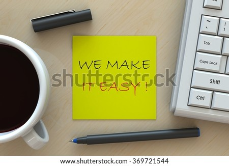 WE MAKE IT EASY!, message on note paper, computer and coffee on table - stock photo