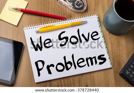We Solve Problems - Note Pad With Text On Wooden Table - with office  tools - stock photo
