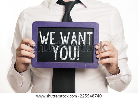 We want you Handwritten with white chalk on a blackboard which holding man - stock photo