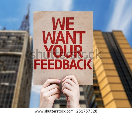 We Want Your Feedback card with a urban background - stock photo