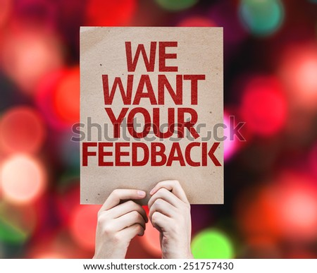 We Want Your Feedback card with colorful background with defocused lights - stock photo