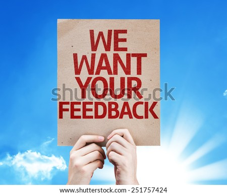 We Want Your Feedback card with sky background - stock photo